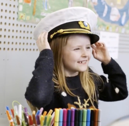 Girl wearing captain's hat